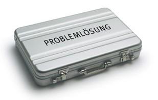 koffer, aufschrift 'problemlösung'