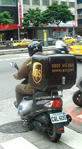 ups-delivery-guy on vespa